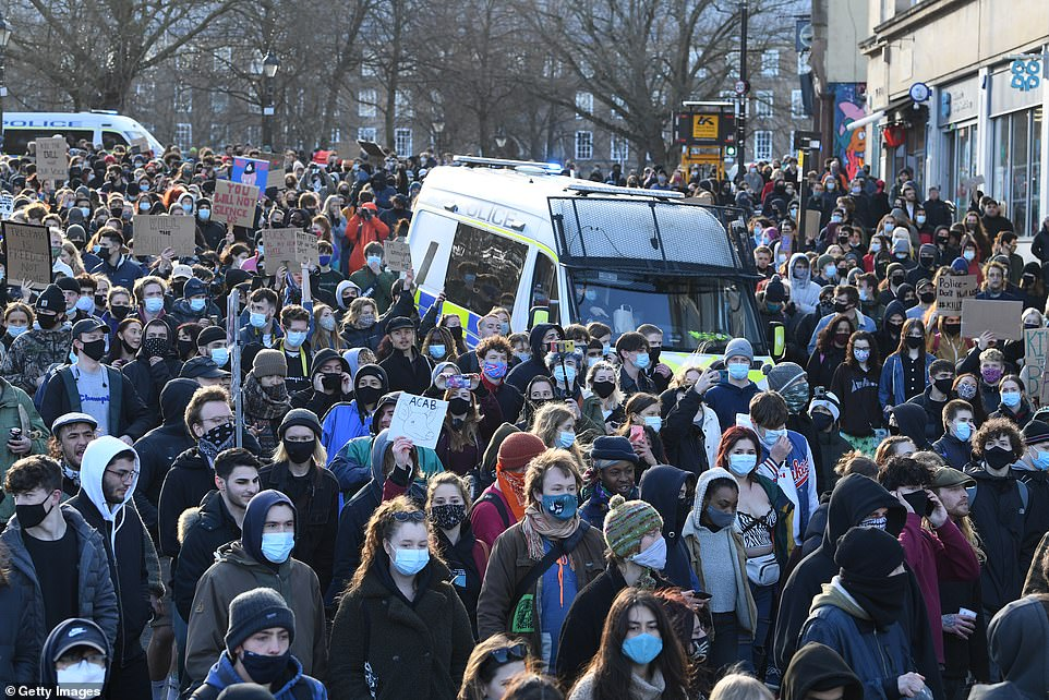 Hundreds of demonstrators stream past police vans in Bristol city centre on Friday evening during a 'kill the bill' demo.Today, National Police Chiefs' Council chairman Martin Hewitt warned that large gatherings remained illegal under the Covid lockdown rules and suggested there were extremist agitators seeking to 'hijack' peaceful protests.