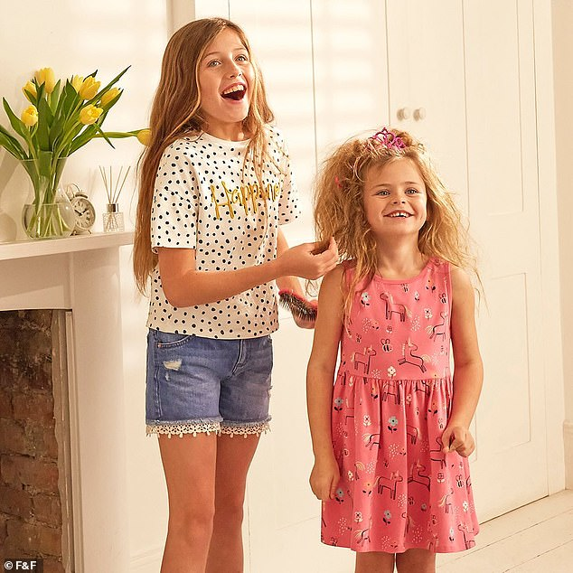 Just like mum! Three of Abbey's four children appeared in the new advert as youngest daughter Liberty, five, and eldest son Johnny, three, posed with fruit on their heads (Sophia, 10, and Liberty pictured)