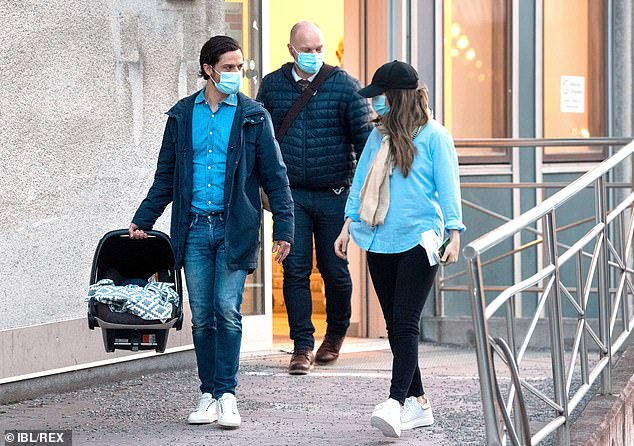 The royal couple, who married in 2015, put safety first in face masks as they made their way home (pictured)