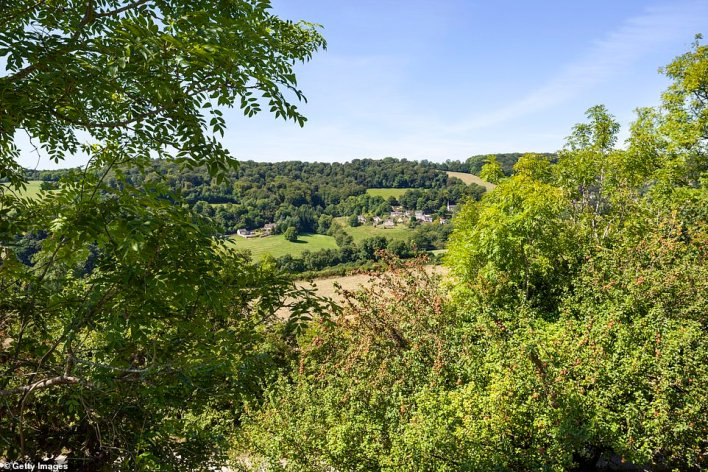 A view of the honeyed-stone Gloucestershire village of Slad from Swift's Hill. The village is where author and poet Laurie Lee grew up