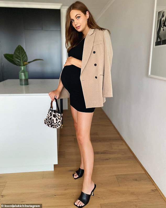Pregnancy glow:Just last week, Ksenija stunned as she showed off her baby bump in a tight minidress and a chic camel blazer