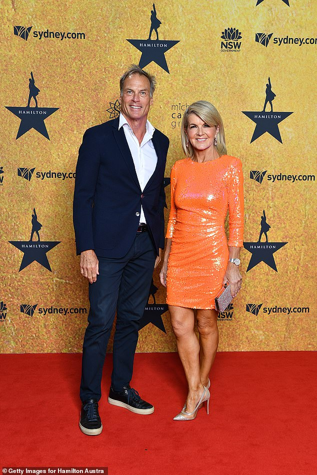 Orange crush:Julie Bishop, 64, went to the event with her hunky partner David Panton, with the former politician turning heads in fitted orange, sequinned frock. Both pictured