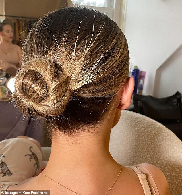 Hair up:Kate tied her blonde tresses into a neat bun, while she accessorised with a gold bracelet and a small ring situated on one of her fingers