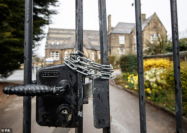 Chained gates at Batley Grammar School, pictured yesterday, afterHeadteacher Gary Kibble kept 980 children at home
