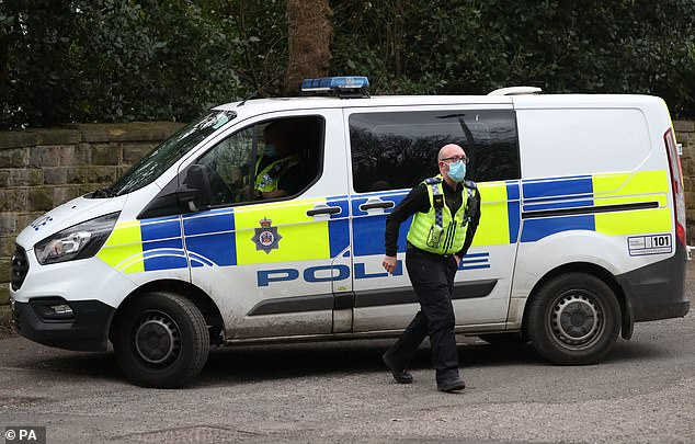 Police (officer pictured arriving at the protest yesterday) are providing support to the teacher after protestors gathered outside the school for a second day