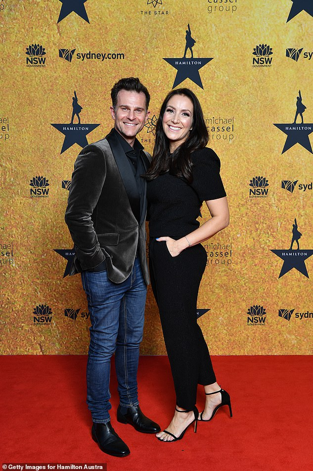 Casually cool:David Campbell and his wife Lisa Hewitt cuddled up together as the posed, with David, 47, wearing a velvet blazer and jeans with boots. Both pictured