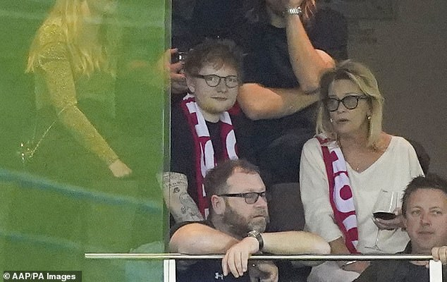 A-team:Ed wore the red, white and black scarf, which bears the same colours as those worn by the St Kilda Saints, seemingly showing his support for the team