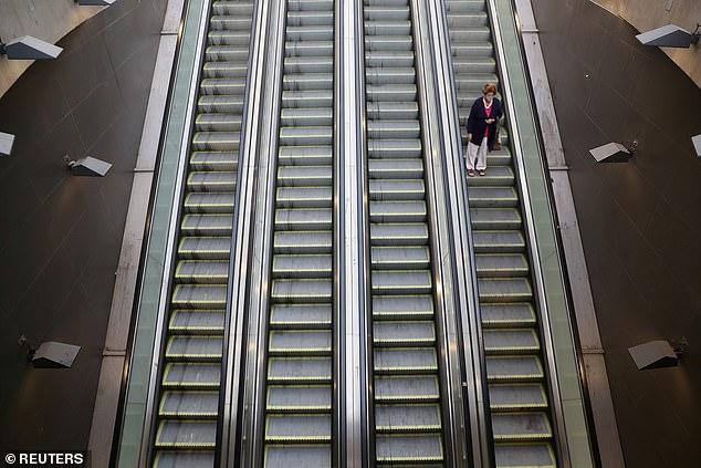 With new virus variants, believed to be more contagious, spreading across the continent, cases have been soaring in Chile despite its vaccination drive. Pictured: A woman uses an escalator at a metro main access as local town halls have increased the lockdown restrictions during the coronavirus disease (COVID-19) outbreak, in Santiago, Chile, March 25, 2021