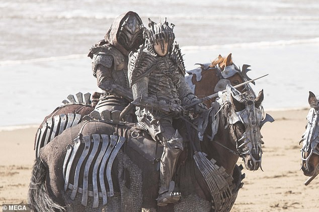 Exciting:Armoured horse riders wielding spears and swords took over a beach in north Devon on Saturday as filming continued for The Witcher's second series