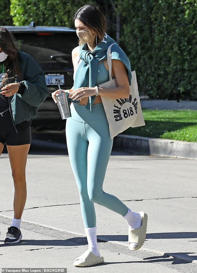 Staying fit: Kendall Jenner was spotted arriving at a West Hollywood Pilates studio while wearing a pair of Yeezy Slides with a group of her pals on Saturday morning