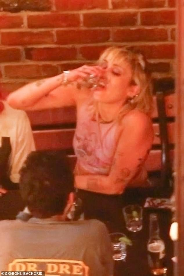 Rager: Miley was seen in other snaps downing shots of tequila