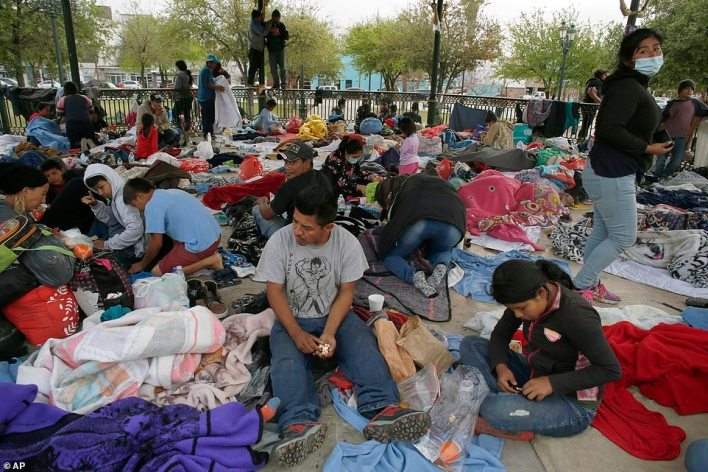 Central American migrants who managed to cross illegally into the US in order to seek asylum sleep in a park in Mexico after being sent back to the country