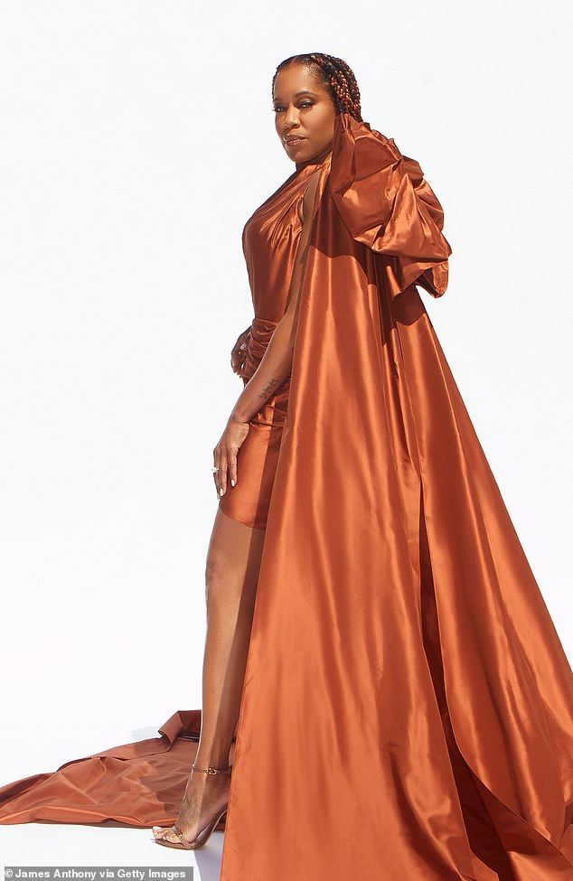 That bow though:The Oscar winner, 50, looked nothing short of magnificent in a custom Oscar de la Renta gown in a beautiful shade of copper