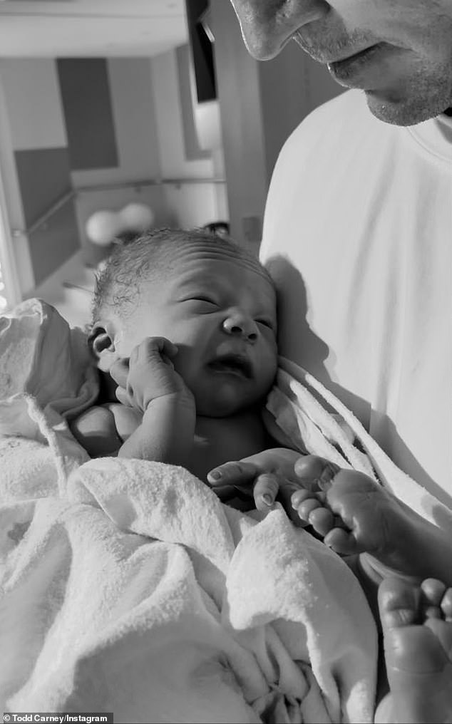 So sweet:Announcing the happy arrival on Sunday, Todd, 34, (pictured) uploaded a series of black and white photos taken inside birthing suite, showing the couple posing with their son
