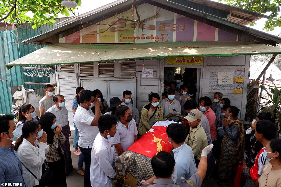 Kyaw was laid to rest draped in the flag of the National League for Democracy, the party of Myanmar's toppled civilian leader Aung San Suu Kyi, who was arrested along with other officials on February 1