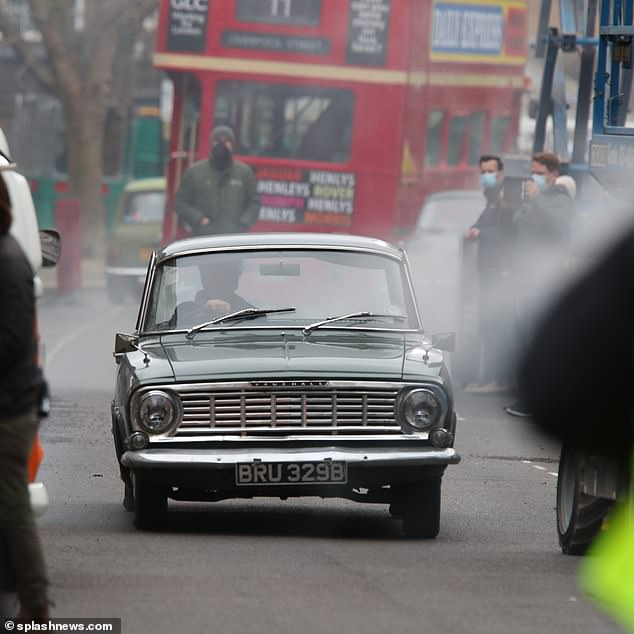 Toot toot! A vintage Vauxhall was also spied on the road