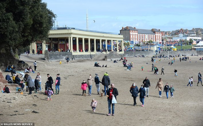 Popular seaside resort Barry Island was jam-packed with beach-goers, some seen having picnics on the sand (pictured)
