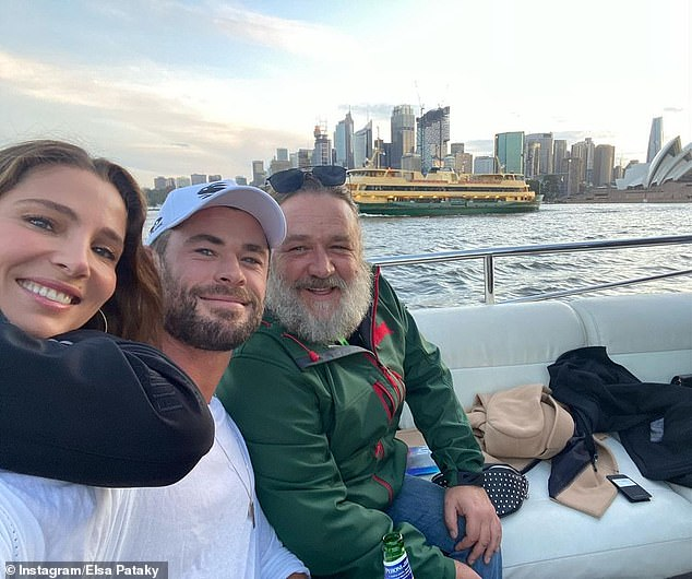 Night at the footy! At the game, Chris (centre) and Elsa (left) joined the likes ofRussell Crowe (right), Taika Waititi and Jeff Goldblum in a private box