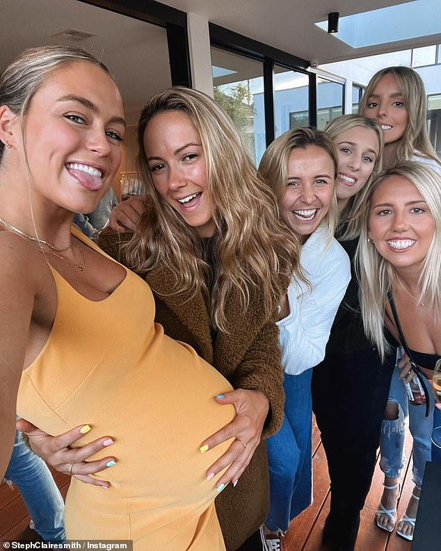 Baby on board:The giddy mum-to-be oozed confidence as she liaised with her guests, wearing minimal make-up on her naturally stunning visage and whisking her hair into a casual ponytail