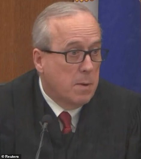 Hennepin County District Court Judge Peter Cahill is seen above in court in Minneapolis on Tuesday