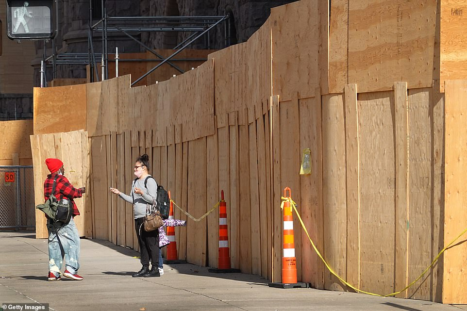 Plywood covers a building front near the Hennepin County Government Center in preparation for the trial on Sunday