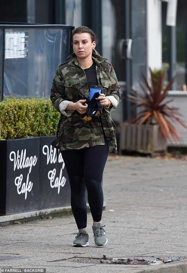 Out and about: Coleen Rooney stepped out in low-key style as she grabbed a coffee at Cafe Nero in Cheshire on Monday