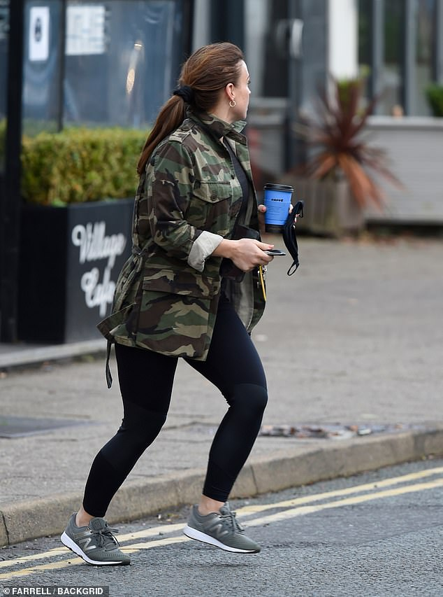 Casual:The media personality styled her brunette locks into a ponytail while she also donned a pair of grey trainers