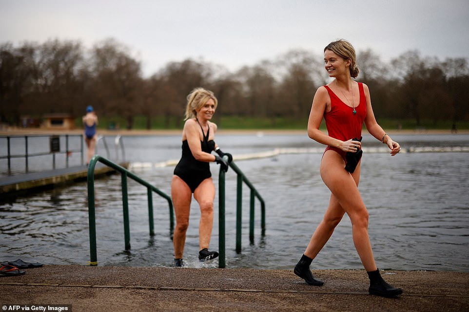 Bathers exit the water after swimming in the Serpentine Lido in Hyde Park, London, on the first day of lockdown easing today
