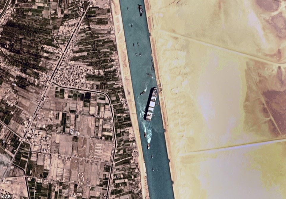 Progress: The Ever Given cargo ship was no longer wedged across the entire width of the Suez Canal today after tugboats managed to dislodge the stern in an early-morning operation