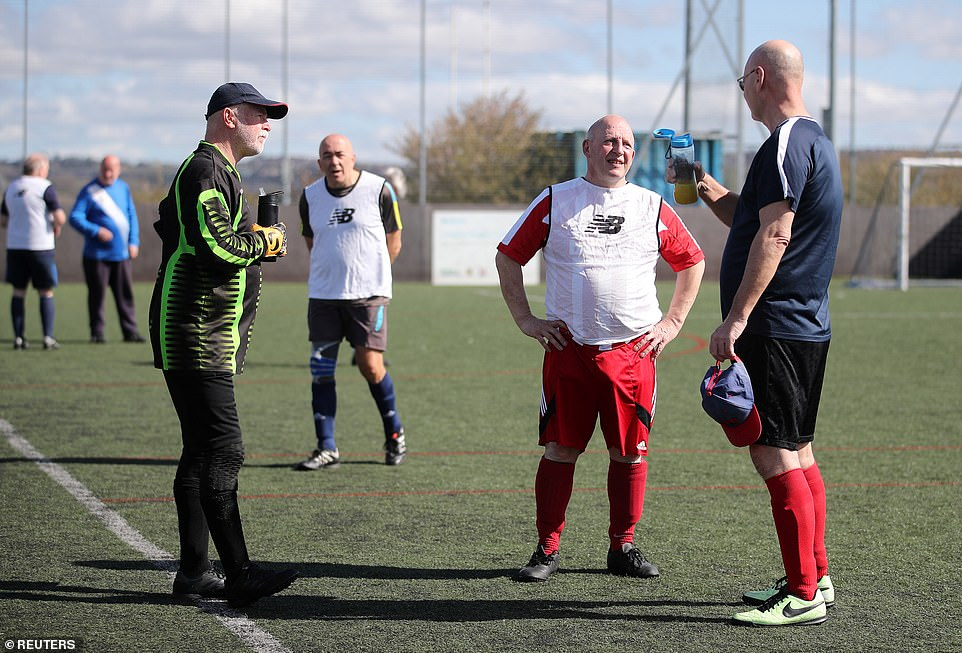 People take a break during Stoke City's Community walking football following the easing of lockdown restrictions