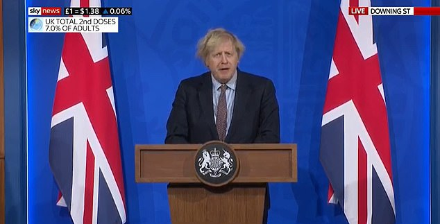 New: Mr Johnson  in front of flags and a cobalt blue backdrop in No9 Downing Street