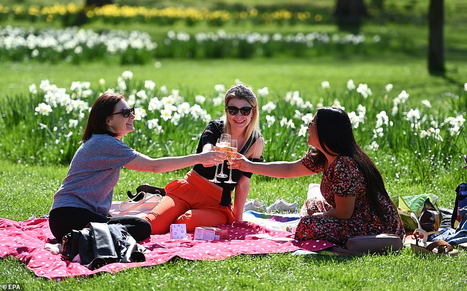 A group of friends enjoy drinks in beautiful spring weather in St James's Park, central London today as the rule of six was reintroduced