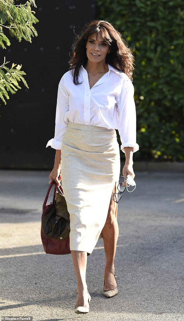 Chic: Jenny Powell proves she still has it as she is spotted leaving a photo shoot in Manchester on Monday