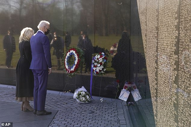 The first couple left a bouquet of white flowers at the base of the Vietnam Veterans Memorial on Monday to mark National Vietnam War Veterans Day