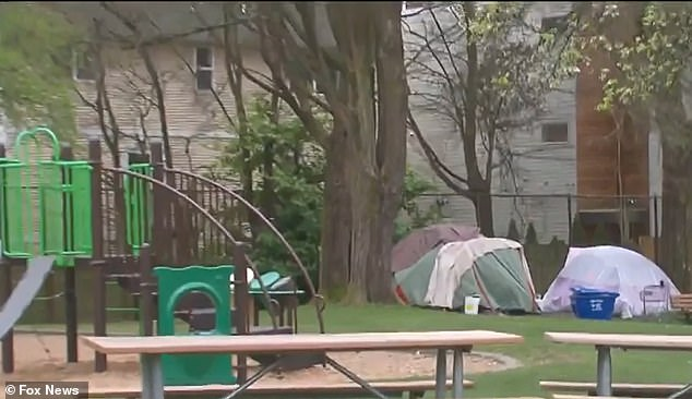 The image above shows a tent encampment inside a children's playground in Seattle