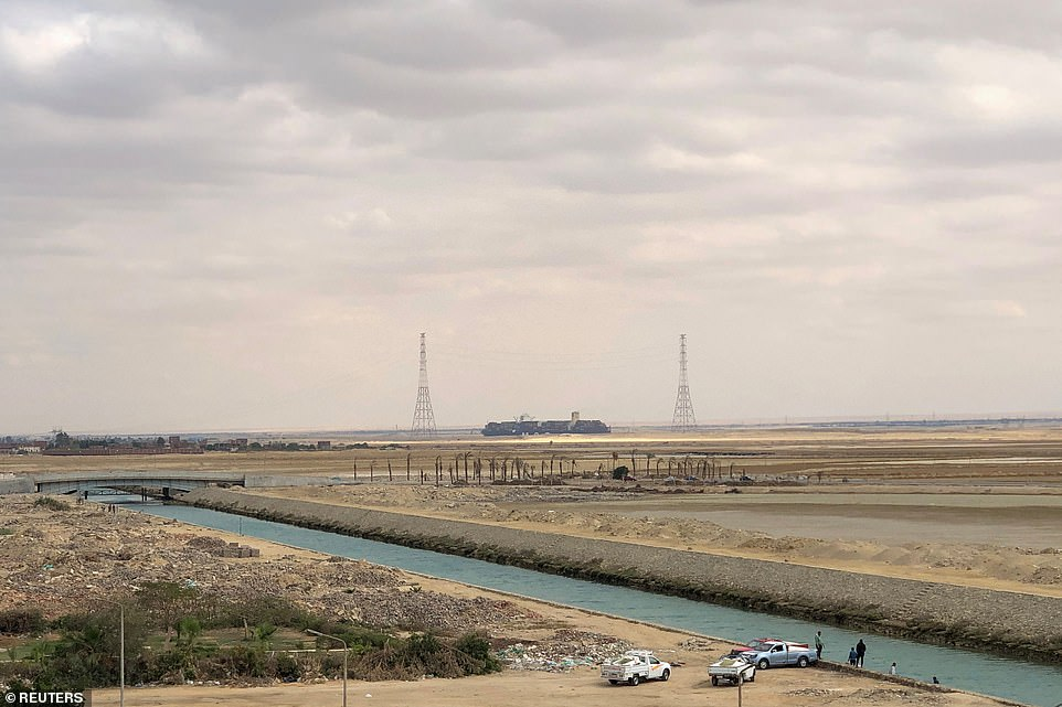 A ship sails through the Suez Canal as the shipping lane re-opened following the week-long saga that disrupted global trade