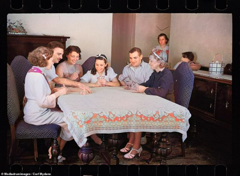 This colorized photograph shows a family sat together round a dining table playing a card game. The picture was taken in one of the new-build homes in the Hightstown project in New Jersey, 1939. It is thought the very earliest versions of modern card games could have been played by the Tang dynasty in 9AD