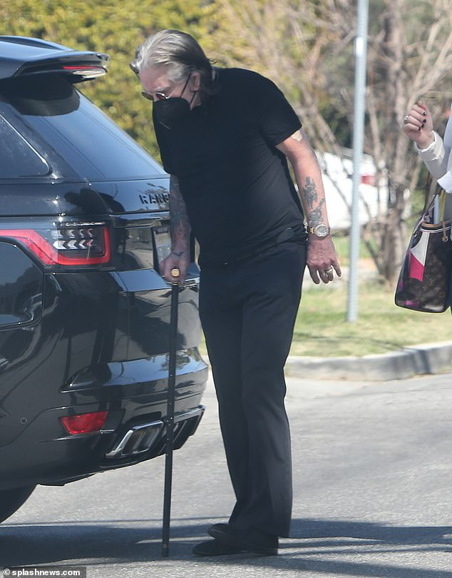 Stepping out:Ozzy Osbourne made his latest appearance in Los Angeles on Monday as beleaguered wife Sharon reportedly prepares to sue CBS following her dismissal from The Talk