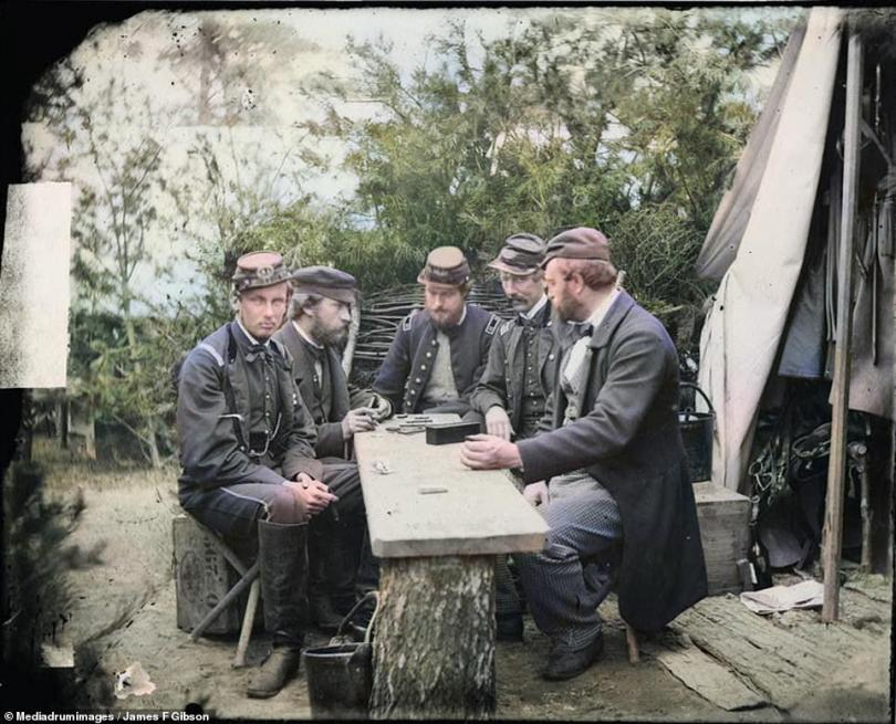 The Duke of Chartres, the Count of Paris and the Price of Joinville sit among a group of soldiers in this colorized picture. The group are concentrating on a game of dominoes at a mess table in Camp Winfield Scott, Yorktown, in 1862. The picture was taken during the American Civil War which raged between the years of 1861 and 1865