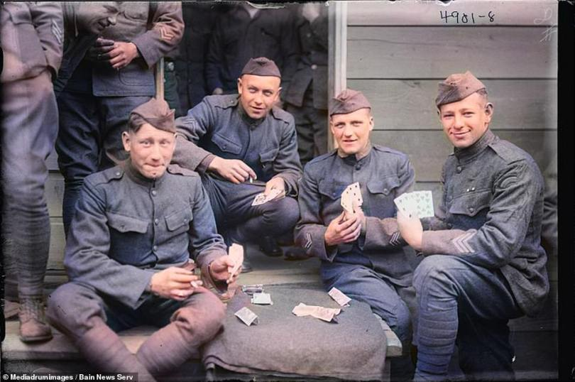 With card games gaining popularity as far back as China in 9 AD it comes as no surprise that soldiers picked up on the habit during their quiet periods. These soldiers, from the 42nd infantry division during the First World War are seen sat on a large step outside of a wooden structure. All four hold out their hands of cards towards the camera