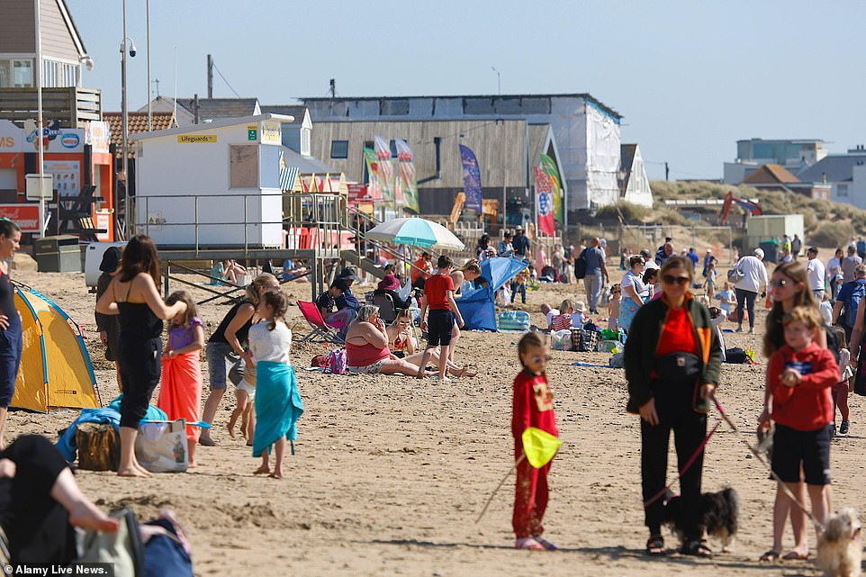 Warm spring sunshine at Camber Sands in East Sussex today as families enjoying the hot weather on the beach