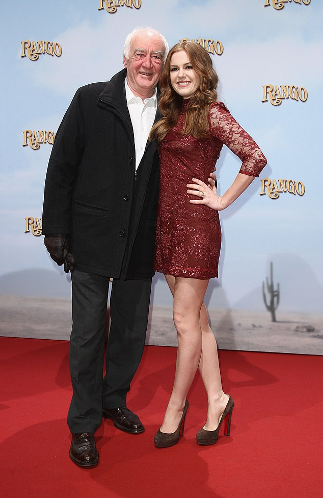 'Poppa Fish': Hollywood actress Isla Fisher, 45, (right) has shared a sweettribute to her father by uploading a throwback photo to her Instagram on Tuesday. Pictured together in 2011