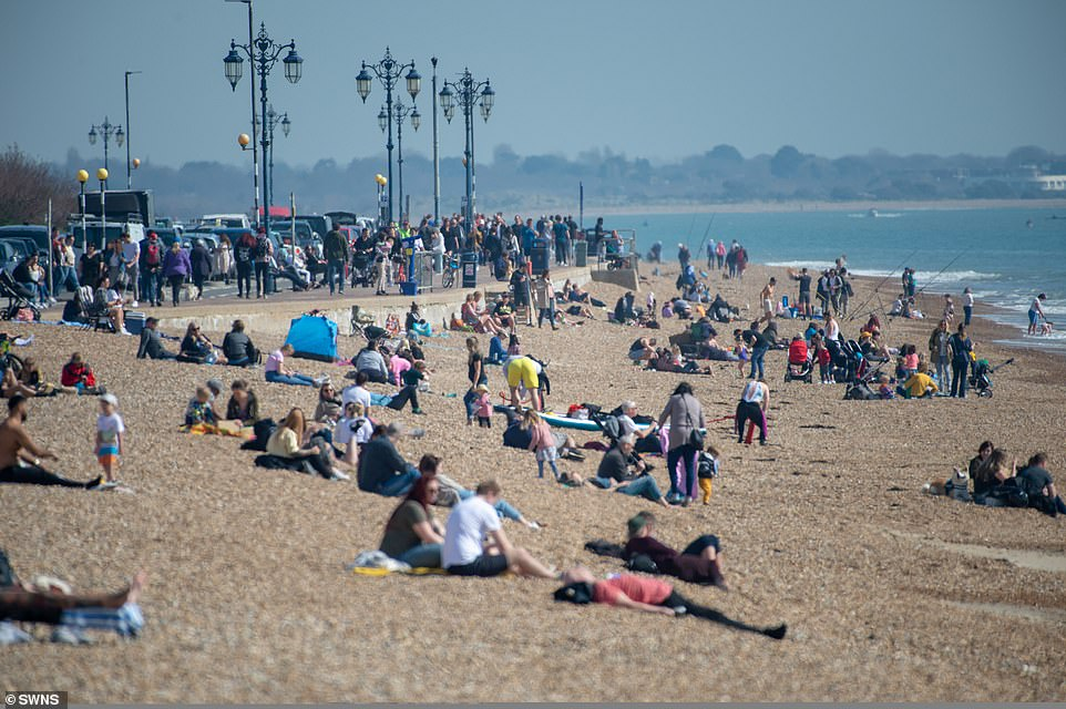People enjoying the warm weather at Southsea in Portsmouth today as the mini-heatwave sweeps over the South
