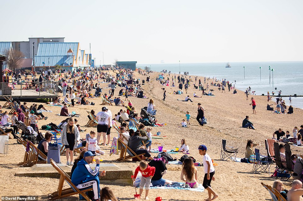 Families head to the beach at Southend-on-Sea in Essex today as they make the most of the warm weather conditions