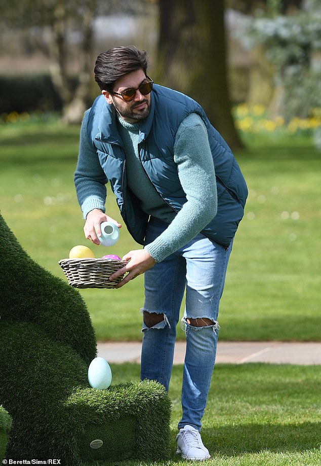 Having fun: Dan, 30, meanwhile opted wrapped up in a teal gilet and a jumper to film the outdoor scenes