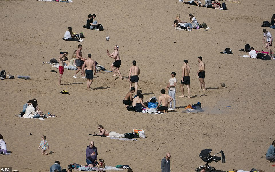 People enjoy the warm weather on Tynemouth Beach on the North East coast this afternoon