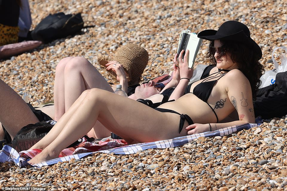 Visitors to Brighton enjoy the warm sunny weather on the beach this afternoon as the South East enjoys hot weather