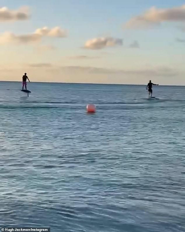 Makes it more fun:Hugh appeared to be enjoying an electronic surfboard session - using a board that was powered by a battery-operated engine