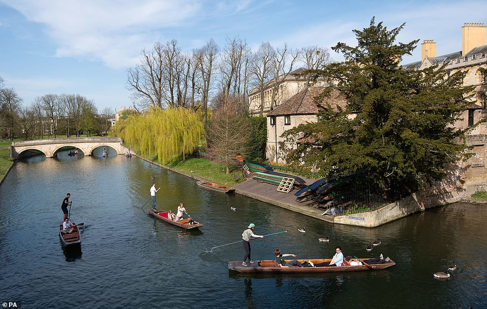 People punt along the River Cam in Cambridge today as temperatures soar in parts of the country