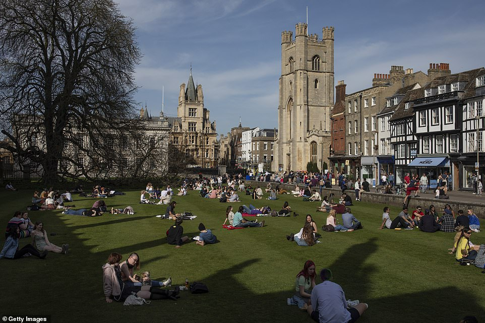 People enjoy the sunshine in Cambridge this afternoon as forecasters reported temperatures in the 70Fs today